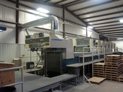 Operators End of the Komori 8000II Platesetter